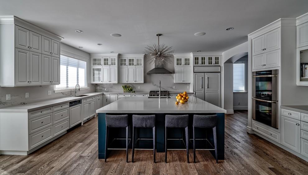 interior design services white kitchen with blue accent on island