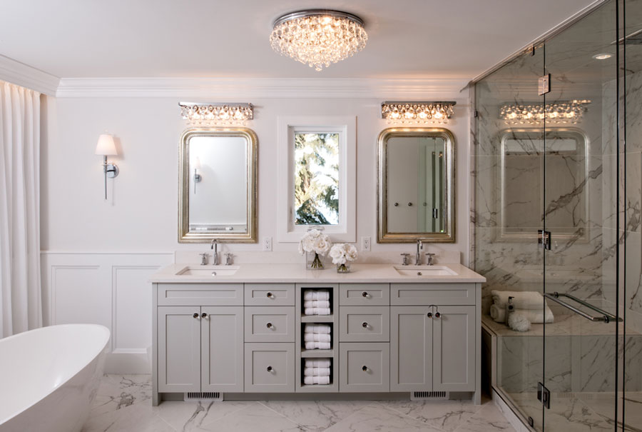 renovation budget - sparkly bathroom with grey double vanity and chandelier
