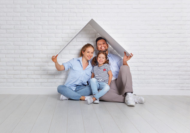 Calgary interior designer - family under cardboard roof in front of white background
