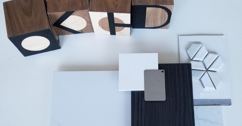 Bathroom renovation - tile samples, cabinet samples and KHD logo blocks.