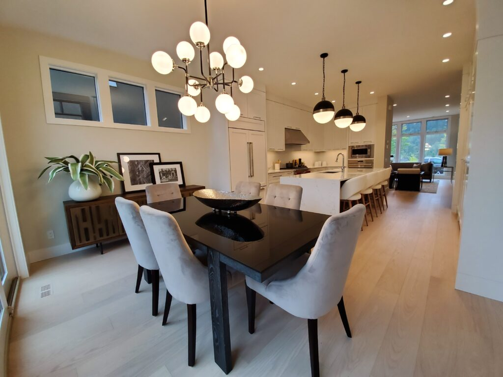 Timeless Design - kitchen and dining area with neutral colours and spherical lighting