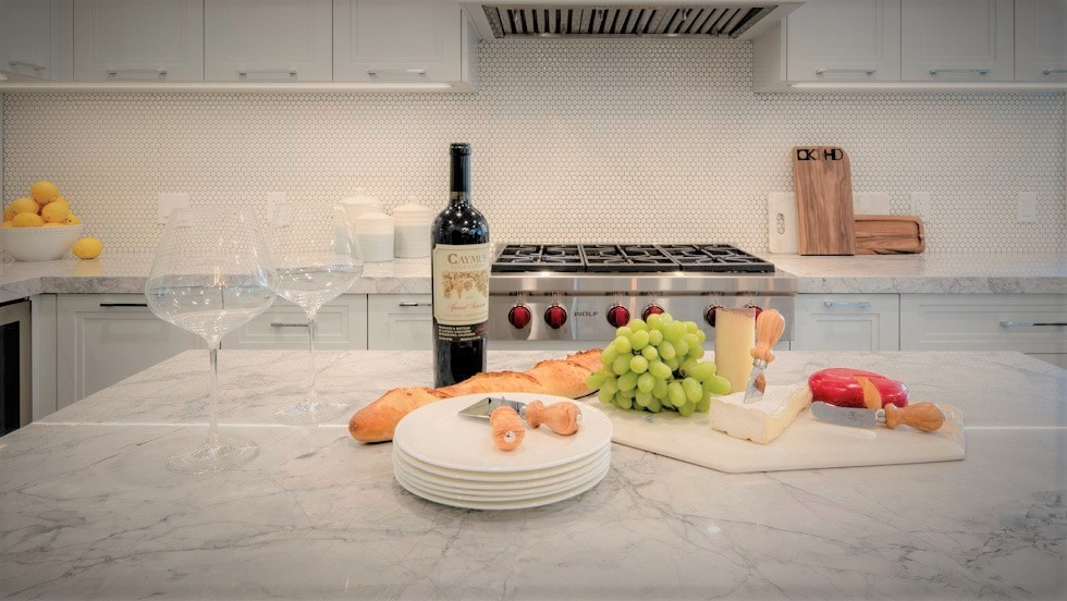 Lagom vs hygge- wine and cheese in a kitchen